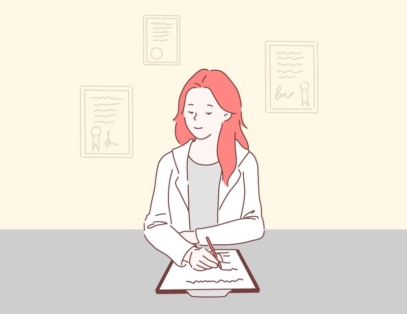 手書きをする女性